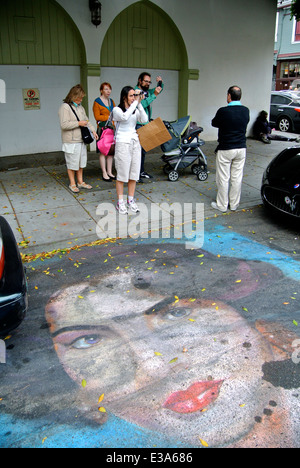tourists take photos on Grant street in front of Street painting - Stock Photo