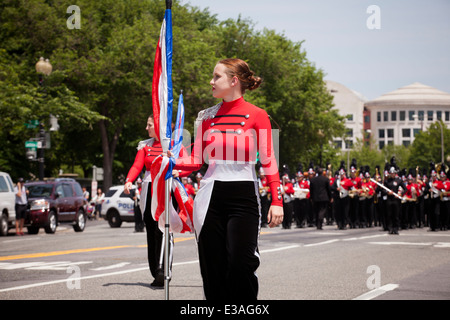 High school marching band color guard member at parade - Washington, DC USA - Stock Photo