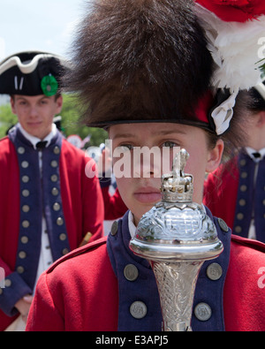 Female US Colonial marching band leader holding baton - USA - Stock Photo
