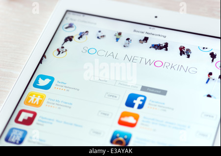 Brand new modern white Apple iPad Air with featured social networking apps in App Store collection - Stock Photo