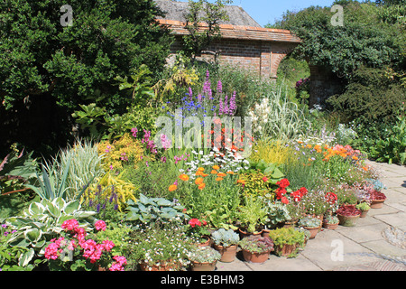Summer flowers in borders and pots in the Wall Garden at Great Dixter, East Sussex, UK - Stock Photo