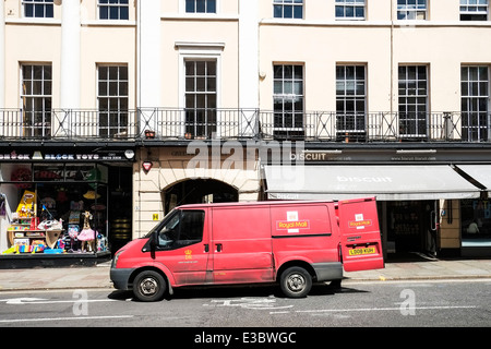 A Royal Mail post office van at the roadside. - Stock Photo