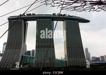 Marina Bay Sands Hotel viewed from Supertree Grove in Gardens By The Bay. - Stock Photo