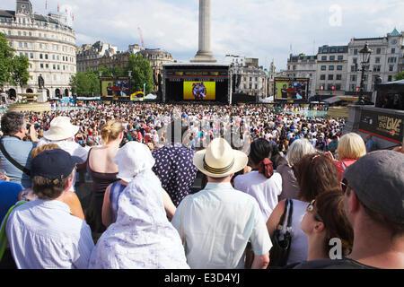 London, Trafalgar Square, UK. 22nd June 2014. Tourists watching London's West End theater in Trafalgar Square. Credit: - Stock Photo