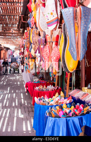 Colourful babouches are displayed in the souks of Marrakesh in Morocco, North Africa. - Stock Photo
