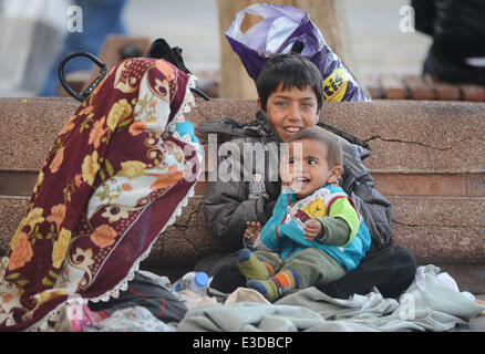 Syrian citizens have fled from Aleppo amid war to Turkey, many with small children, in search of a safe haven. According - Stock Photo