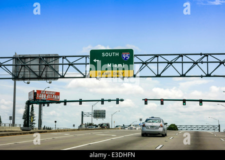 Overhead sign on I95 South to Miami in Florida - Stock Photo