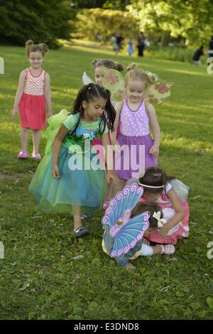 June 21, 2014 - Old Westbury, New York, U.S - 15-month-old JASMINE DELGADO, wearing blue fairy wings, fell on the - Stock Photo