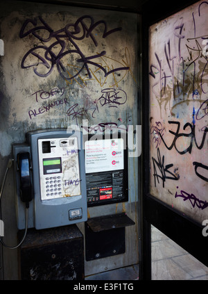 Vandalized Phone Box - Stock Photo