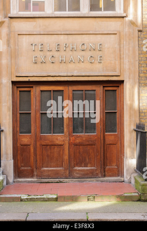 Door into an old Telephone Exchange - Stock Photo
