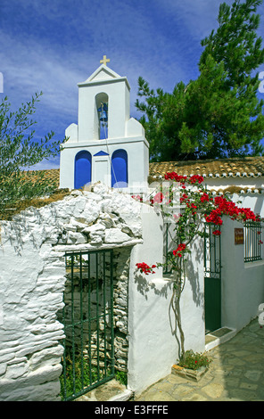 A traditional church in a picturesque alley in Dryopida (Driopida) village, Kythnos island, Cyclades, Greece - Stock Photo