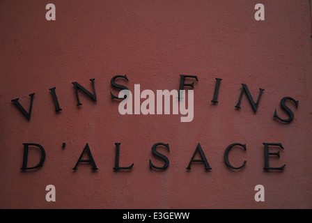 Wine cellar sign on a house wall in Alsace, France - Stock Photo