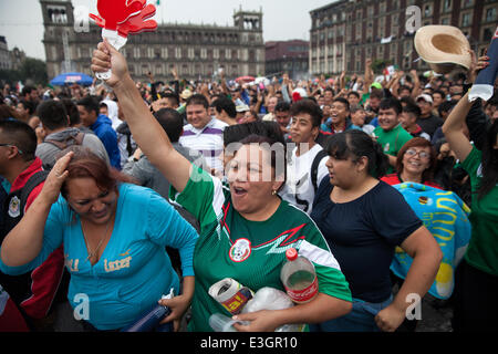 Mexico City, Mexico. 23rd June, 2014. Mexico's fans celebrate. Thousands of fans gather to watch the transmission - Stock Photo