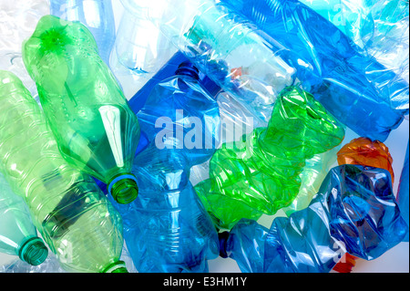 crushed multicolored plastic bottles background - Stock Photo