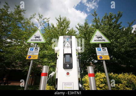 plug plugging in socket sockets recharge up batteries electrical cable cables battery nissan leaf at trowel motorway - Stock Photo