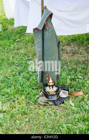 German army uniform of the First World War period waits for its owner in a military camp - Stock Photo