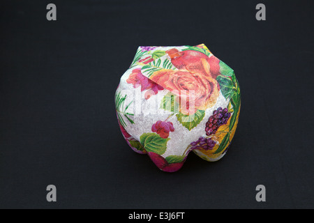 Colourful, collectable designer boxes, jar, vase imported from South Africa, made from recycled, reused, plastic - Stock Photo