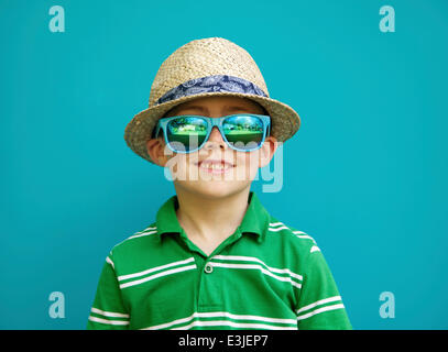 Smiling Boy Wearing Straw Hat and Sunglasses - Stock Photo