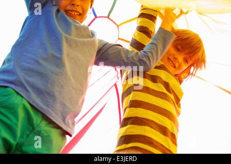 Children Playing under Parachute - Stock Photo