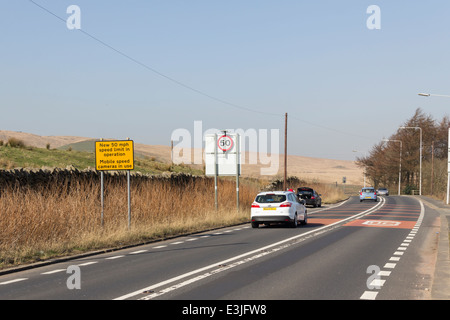 Yellow sign announcing a new speed limit of 50mph on the A675 Belmont Road, Belmont, Lancashire. - Stock Photo