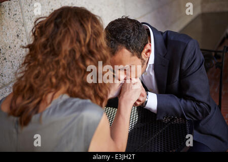 Man Kissing Woman's Hands - Stock Photo