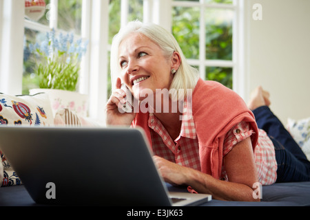 Middle Aged Woman Ordering Item On Telephone - Stock Photo
