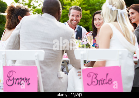 Friends Proposing Champagne Toast At Wedding - Stock Photo