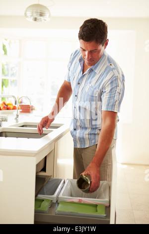 Man Recycling Kitchen Waste In Bin - Stock Photo