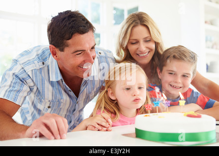 Family Celebrating Daughters Birthday With Cake - Stock Photo