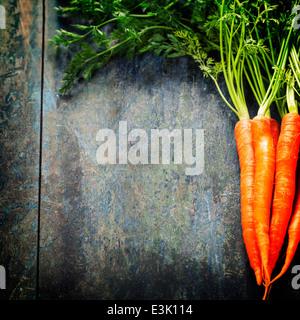 fresh carrots bunch on wood - Stock Photo