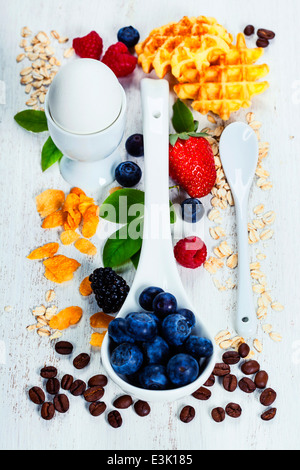 Healthy Breakfast.Oat flake, berries and coffee on wooden table. Health and diet concept - Stock Photo