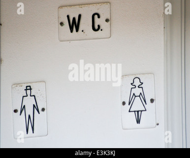 Toilet sign with diagrams of man and woman, Kos Town, Kos, Greece - Stock Photo