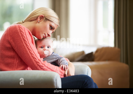 Mother Suffering From Post Natal Depression - Stock Photo