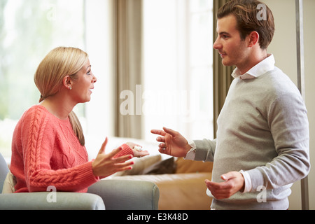 Young Couple Having Argument At Home - Stock Photo