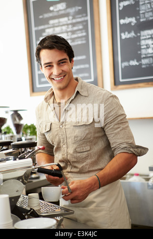 Male Owner Of Coffee Shop - Stock Photo