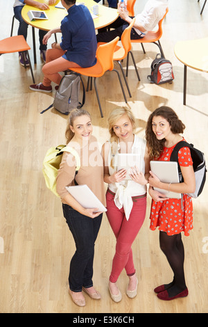 Overhead Shot Of Female Students Standing In Cafeteria - Stock Photo