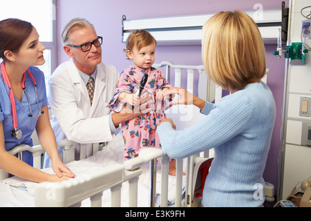 Mother And Daughter In Pediatric Ward Of Hospital - Stock Photo
