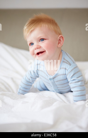 Young Baby Boy Playing In Bed - Stock Photo
