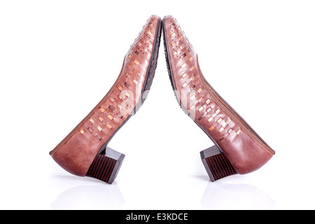 Elegant pair of brown woman's shoes isolated on a white background - Stock Photo