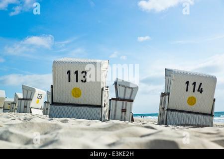 wicker beach chairs near Kampen on Sylt,  Germany - Stock Photo