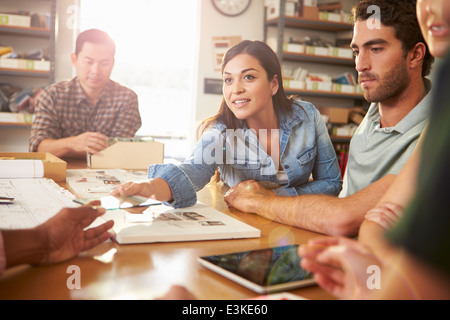 Five Architects Sitting Around Table Having Meeting - Stock Photo