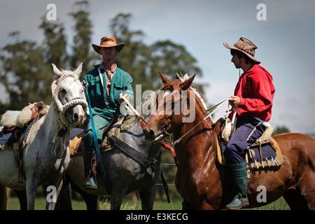 Gauchos on horseback.Uruguay - Stock Photo
