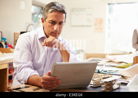 Architect Making Model In Office Using Digital Tablet - Stock Photo