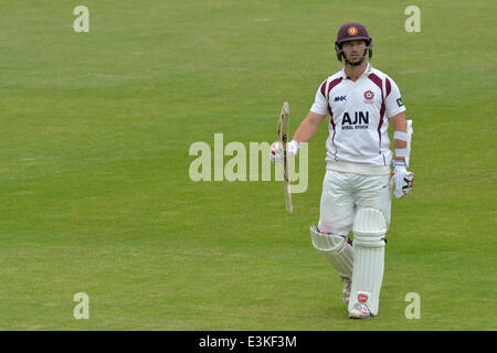 Emirates Old Trafford  Manchester, UK  24th June 2014 Steven Crook (Northants)  makes his way back to the pavilion, - Stock Photo