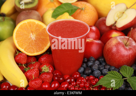 Freshly squeezed juice from red fruits in a cup - Stock Photo