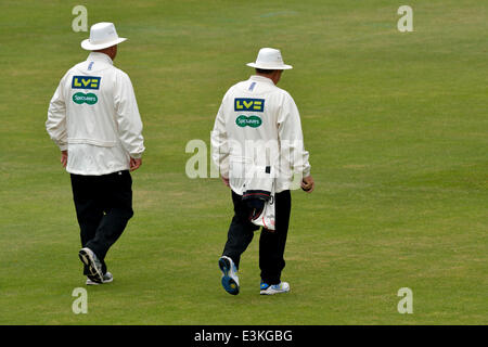 Emirates Old Trafford  Manchester, UK  24th June 2014 Umpires Nigel Cowley and David Lloyd go to the wicket at the - Stock Photo