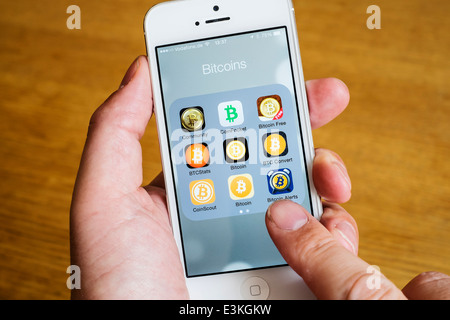 Detail of many Bitcoin apps on iPhone smart phone - Stock Photo