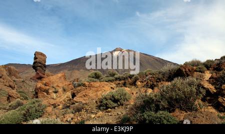 El Teide Volcano, highest summit on the Spanish Canary island of Tenerife with famous Roque Cinchado in foreground - Stock Photo
