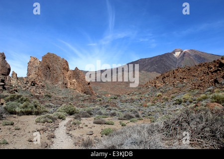 El Teide Volcano, highest summit on the Spanish Canary island of Tenerife, Roques de García in foreground - Stock Photo