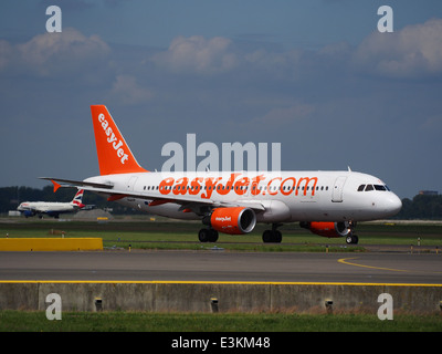G-EZTX easyJet Airbus A320-214 taxiing at Schiphol (AMS - EHAM), The Netherlands, 18may2014, pic-1 - Stock Photo